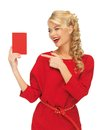 Lovely woman in red dress with note card picture of Royalty Free Stock Photo