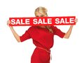 Lovely woman in red dress with sale sign picture of Royalty Free Stock Photo