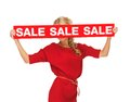 Lovely woman in red dress with sale sign picture of Royalty Free Stock Images