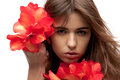 Lovely woman with red flowers picture of Royalty Free Stock Image