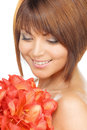 Lovely woman with red flowers picture of Stock Photos