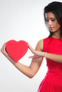 Lovely woman with red heart shaped gift box Royalty Free Stock Photo