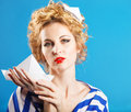Lovely woman retro portrait on blue background Stock Photography