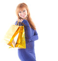 Lovely woman with shopping bags over white background Royalty Free Stock Photos