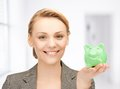 Lovely woman with small piggy bank Royalty Free Stock Photos