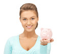 Lovely woman with small piggy bank Stock Image
