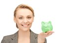 Lovely woman with small piggy bank picture of Royalty Free Stock Photo