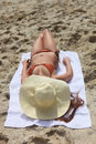 Lovely woman sunbathing outdoors at the beach Royalty Free Stock Photos