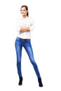 Lovely woman in white shirt and blue jeans isolated on background Stock Image