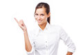 Lovely woman in white shirt pointing at copyspace against background Royalty Free Stock Image