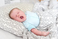 Lovely yawning 1 months baby girl in the parents bed Royalty Free Stock Photo