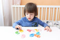 Lovely 2 years child learns to count at home Royalty Free Stock Photo