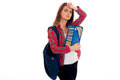 Lovely young brunette students teenager in stylish clothes and backpack on her shoulders posing isolated on white Royalty Free Stock Photo