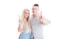 Lovely young couple showing peace or victory sign Royalty Free Stock Photo