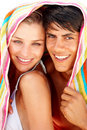 Lovely young couple with towel over their head Royalty Free Stock Images