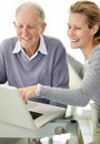 Lovely young female using laptop with her father Stock Photography