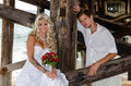 Lovely young married couple a beautiful posing at the beach Stock Photography