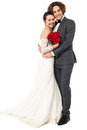 Lovely young married couple embracing warmly handsome groom his darling wife Stock Images