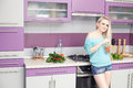Lovely young pregnant woman enjoying fresh fruit juice in her mo smiling modern kitchen indoor shot Royalty Free Stock Images