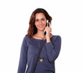 Lovely young woman conversing on phone portrait of a in blue while standing isolated background Stock Image