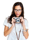 Lovely young woman holding an old camera on white Stock Photos