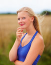 Lovely young woman in a pleasant mood at the farm Stock Image