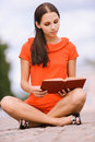 Lovely young woman reads book Stock Images