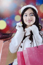 Lovely young woman with shopping bags portrait of beautiful asian wearing a winter coat and carry Stock Photography