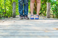 Lover feet standing on the wood bridge in thailand Royalty Free Stock Photo