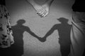 Lover holding hand shadow of couple reflected on a pavement in the sunset light Stock Photo