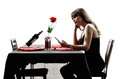 Lover woman waiting for dinner silhouettes one dinning in on white background Royalty Free Stock Photos