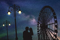Lovers in amusement park at night Royalty Free Stock Photo