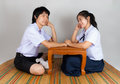 Lovers of asian thai high school students girlfriend holds boyfriend s hand with love Royalty Free Stock Image