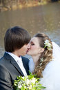 Lovers honeymoon bride and groom on the background of the autumn forest and river Royalty Free Stock Images