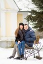 Lovers kissing bench winter park Royalty Free Stock Photos