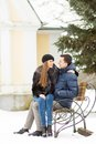 Lovers kissing bench winter park Royalty Free Stock Photo