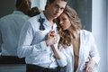 Lovers man and woman in white shirt holding hands men women passionate couple dress shoot Stock Photos