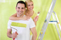 Lovers with paint brush painting portrait of smiling Stock Images