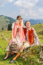 Lovers pants in fashionable traditional Bavarian Dirndl and leather with hat Royalty Free Stock Photo