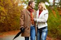 Lovers in park portrait of affectionate couple taking a walk autumnal Stock Photo