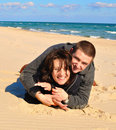 Lovers on the sand Royalty Free Stock Photography