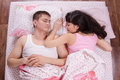 Lovers sleeping in bed girl buried nose her husband lying Stock Image