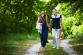 Lovers walking in forest