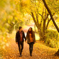 Lovers walking hand in hand autumn park Stock Photo