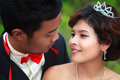Loving asian couple faces in closeup Stock Images