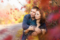 Loving couple in the autumn garden. Stock Photo