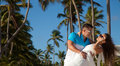 Loving couple beach at summer the romantic date or wedding o young honeymoon on dominicana together in love holding around each Stock Images