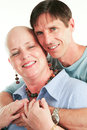 Loving couple beats cancer husband supporting his wife through her treatment Stock Image