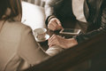 Loving couple dating at the bar he is holding her hand and comforting her Royalty Free Stock Photo