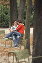 Loving Couple Eating Snack In Park Royalty Free Stock Photo